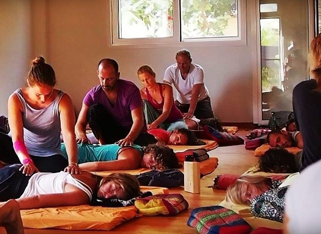 Yoga techniques done in groups to assist one another