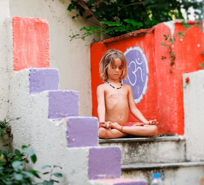 A younger child practices yoga