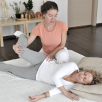 Woman helps another woman stretch out