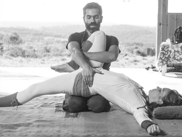 A man uses his whole body to stretch out her whole body