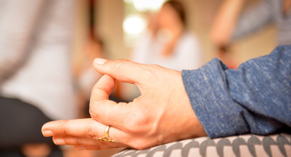 A hand is put into a specific position for mediation