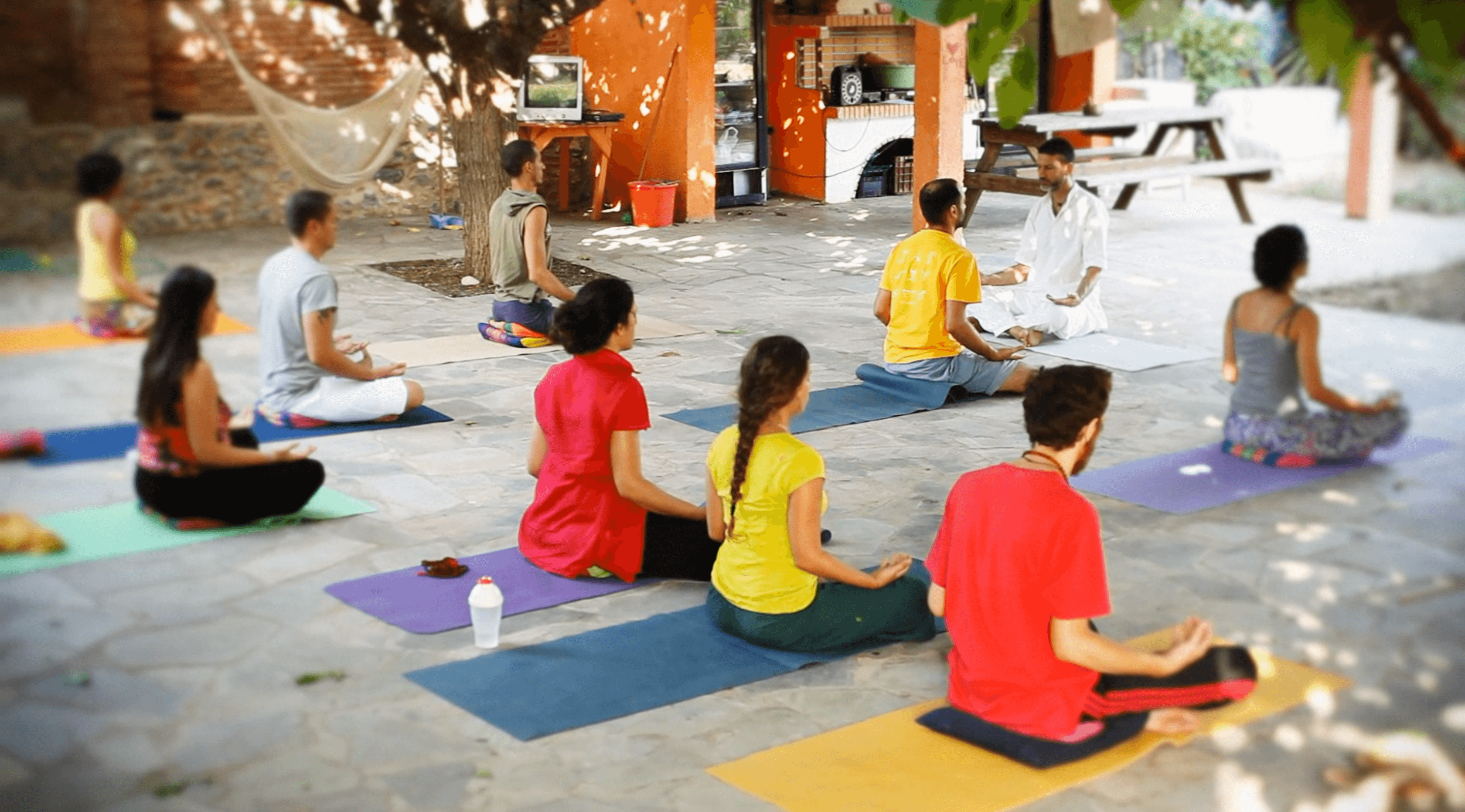 A group of people meditate along side one another