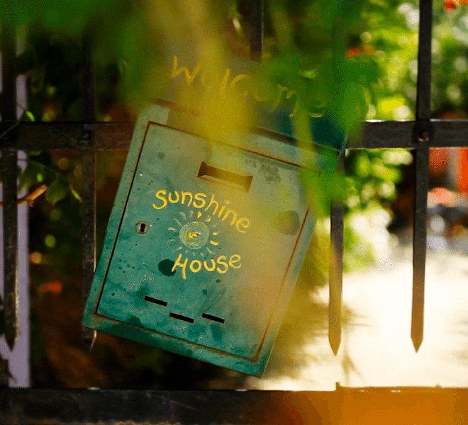 Sunshine House welcome sign