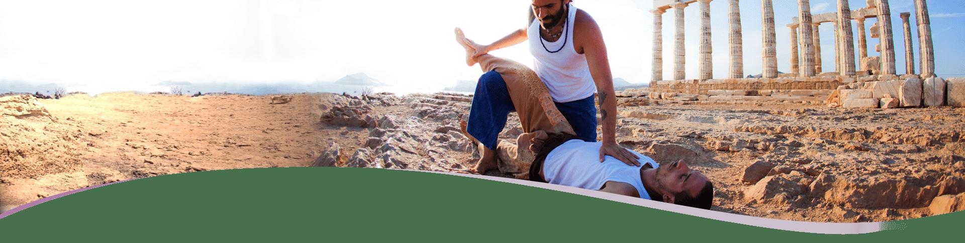 Two men practice yoga on tough ground